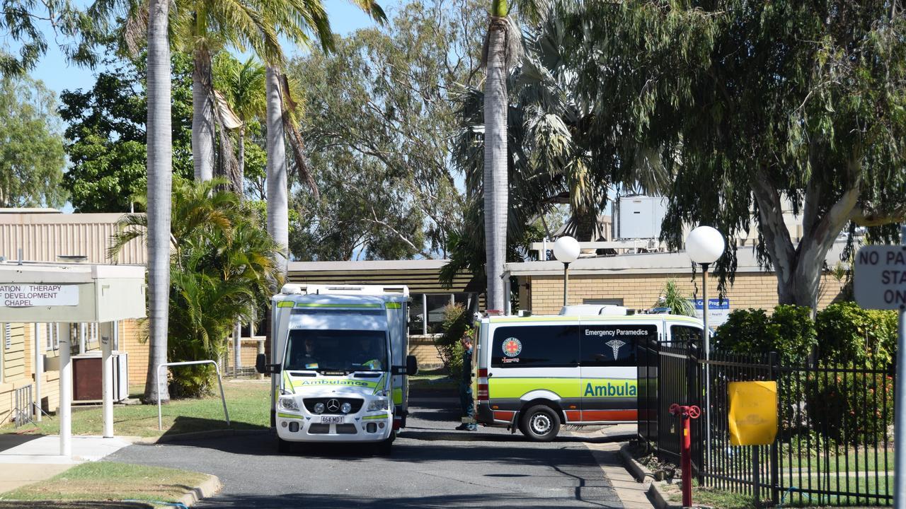 Ambulances queue outside of North Rockhampton Nursing Centre as the transfer of some patients commences last month.