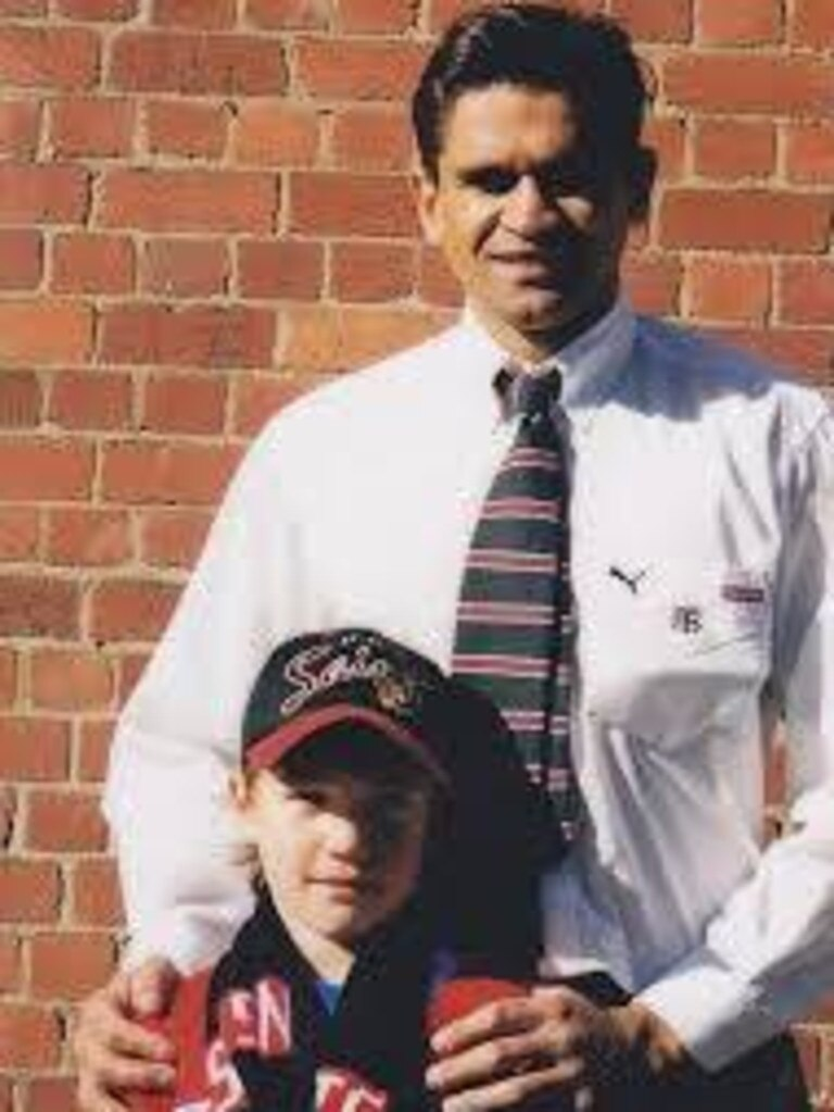 A young Dustin Martin with Nicky Winmar.
