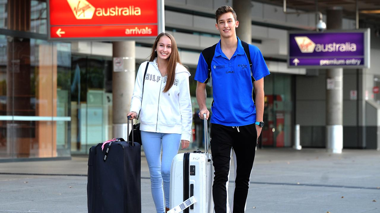 Brooke Hoffmann and Connor Roduner arrive at the Brisbane airport from Cairns. Picture: John Gass