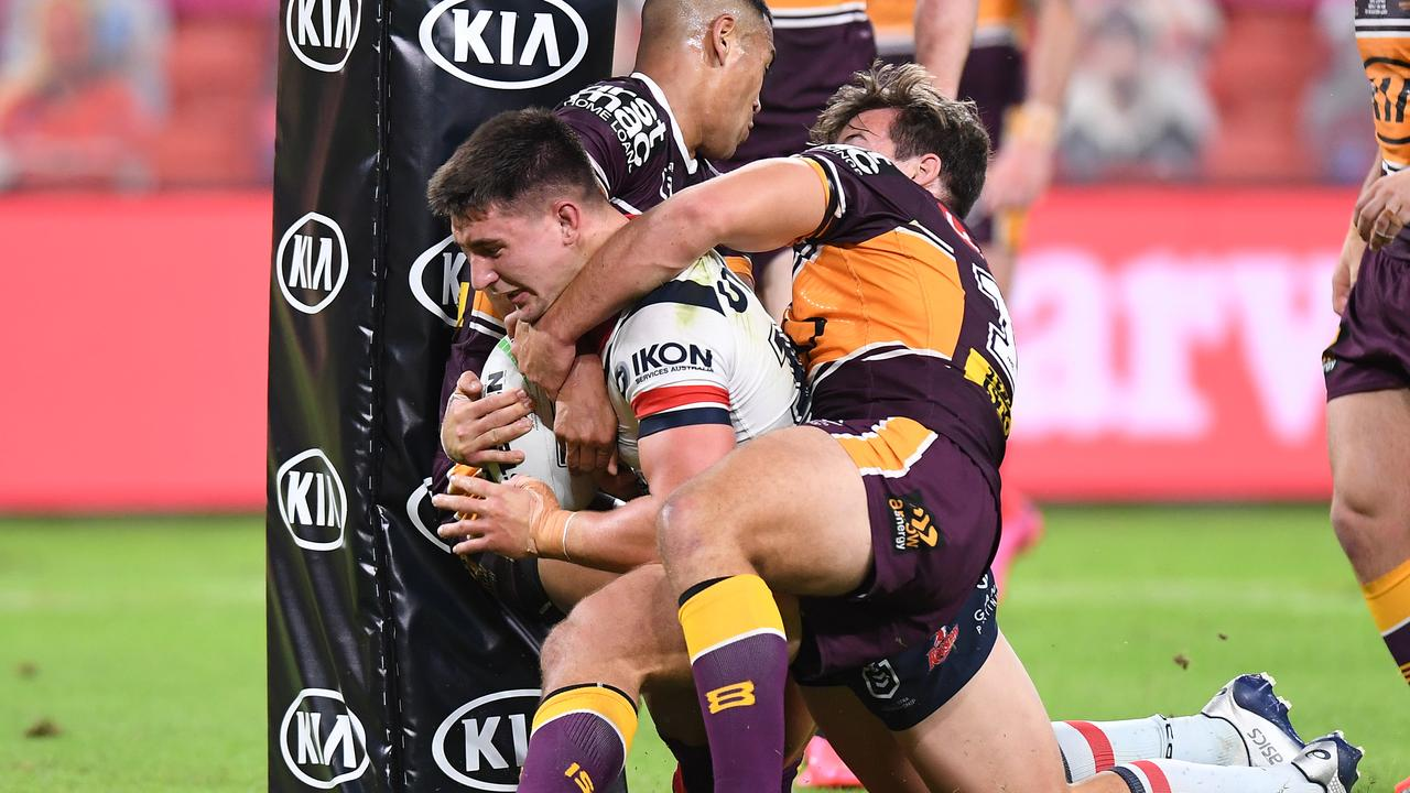Two Broncos can't stop Victor Radley. Photo: Bradley Kanaris/Getty Images