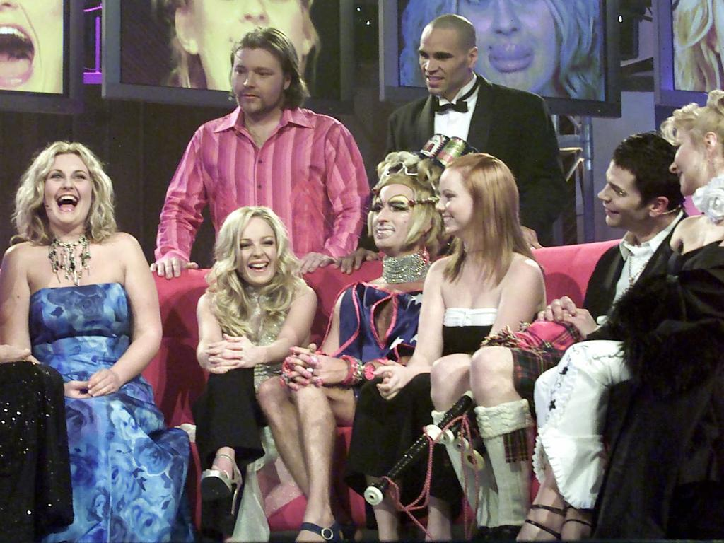 Contestants (from left) Sara-Marie Fedele, Imogen Bailey, Kyle Sandilands (back row), Vanessa Wagner, Anthony Mundine (back row right), Kimberley Cooper, Dylan Lewis, Adriana Xenides, on the Celebrity Big Brother set 2002.