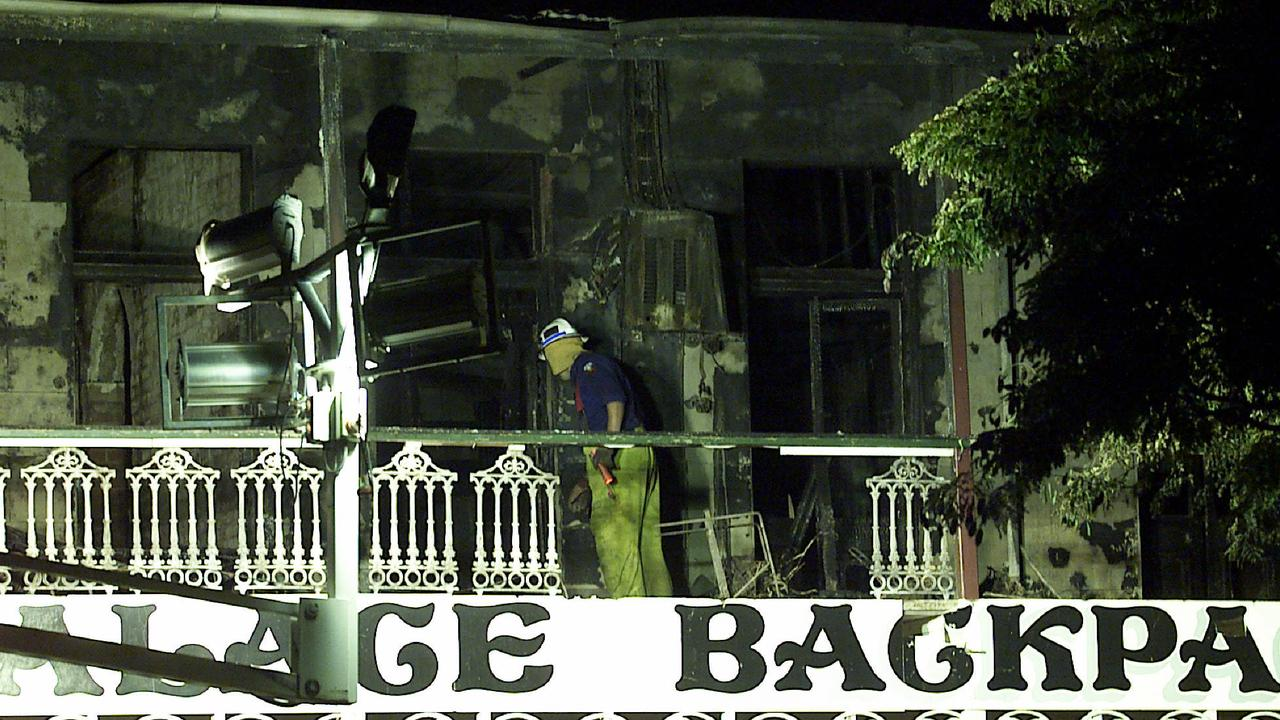 A fireman sifts through wreckage of the building.