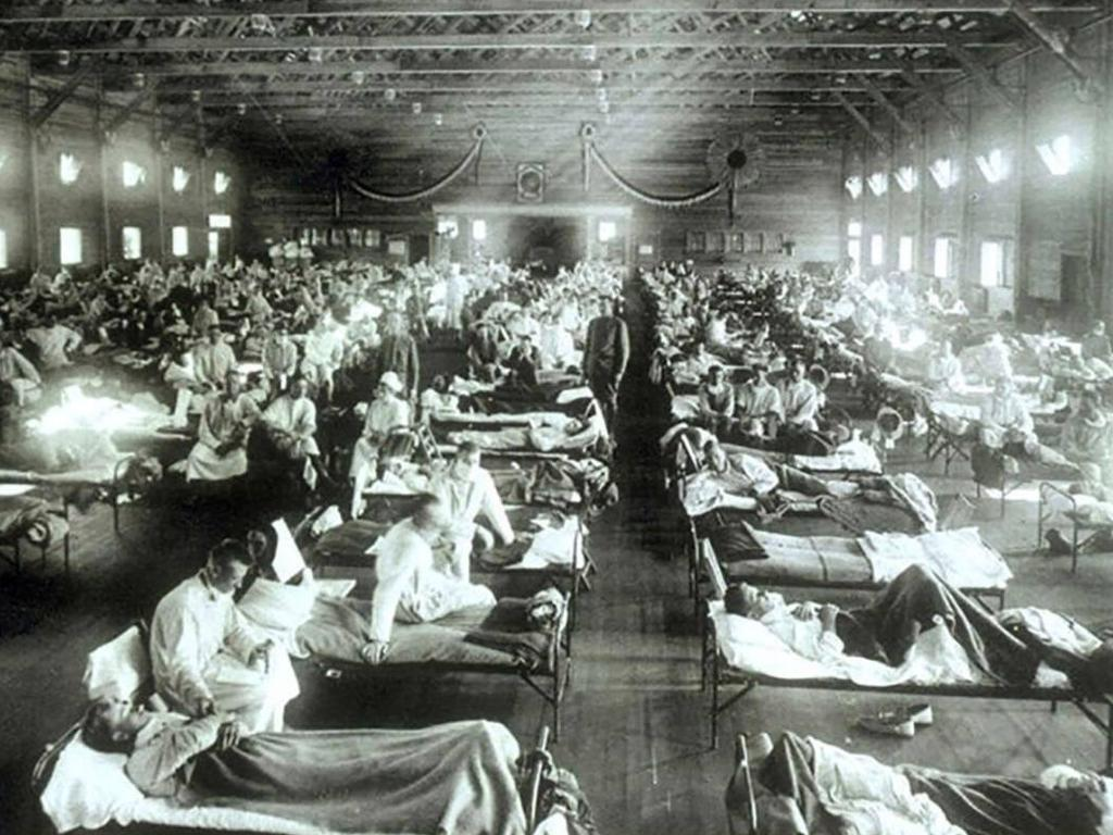Soldiers from Fort Riley, Kansas, suffering from Spanish flu are hospitalised in a converted building at Camp Funston where some of the first cases of the outbreak were recorded.