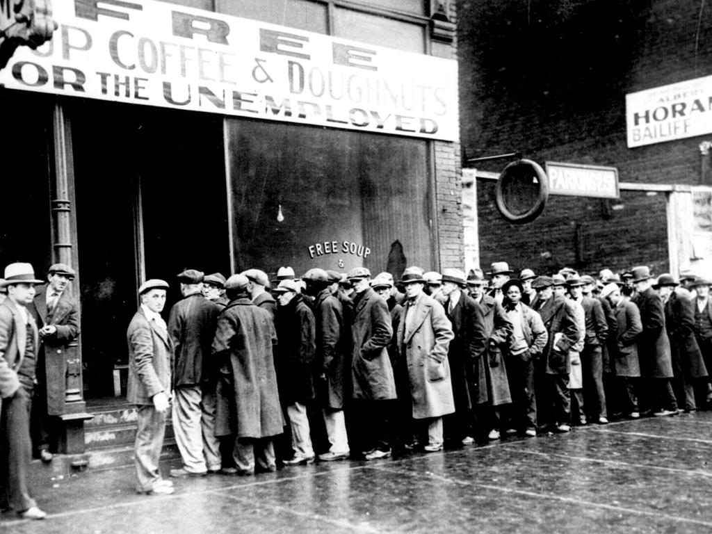 Unemployed men queuing outside a soup kitchen in New York during the Great Depression. Picture: Universal Images Group