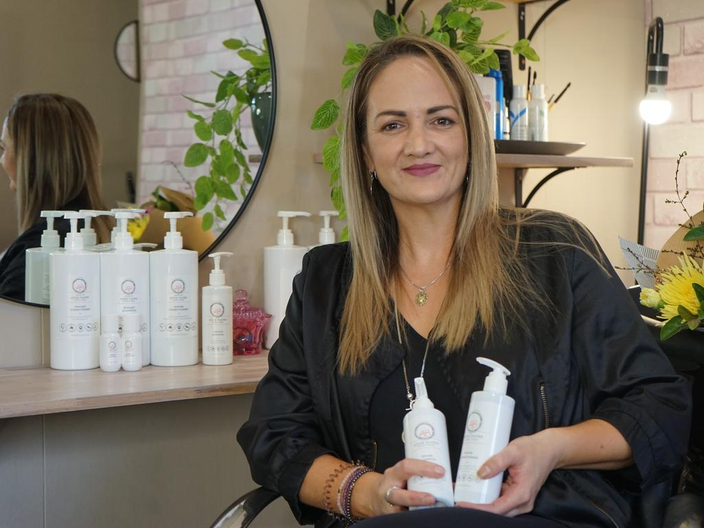 Alice Burke with her own range of hair products, Alice Burke Hair Care.