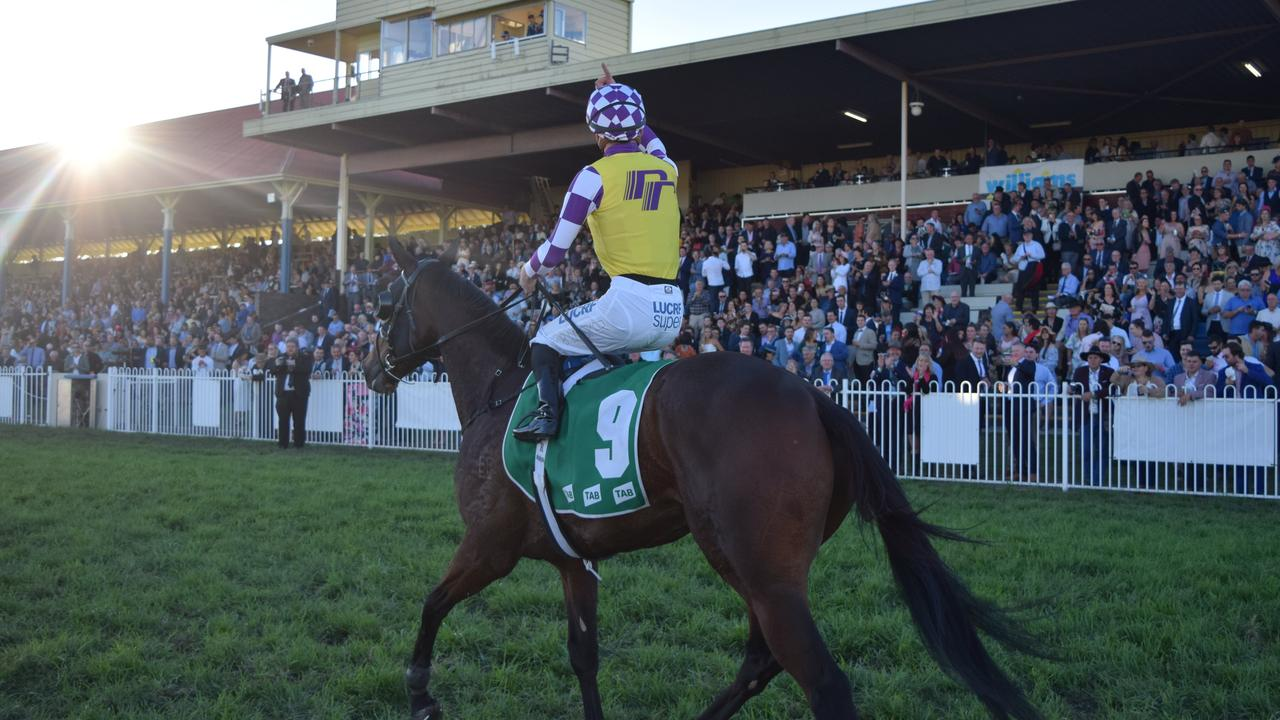 Ben Looker wins the 2019 Grafton Cup aboard Sacred Day.