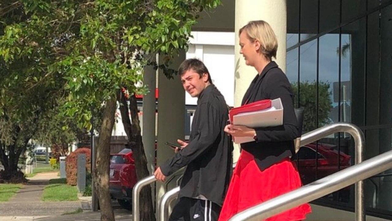 Harley John Ellison, 20, leaves court with lawyer Jane Bruxner.