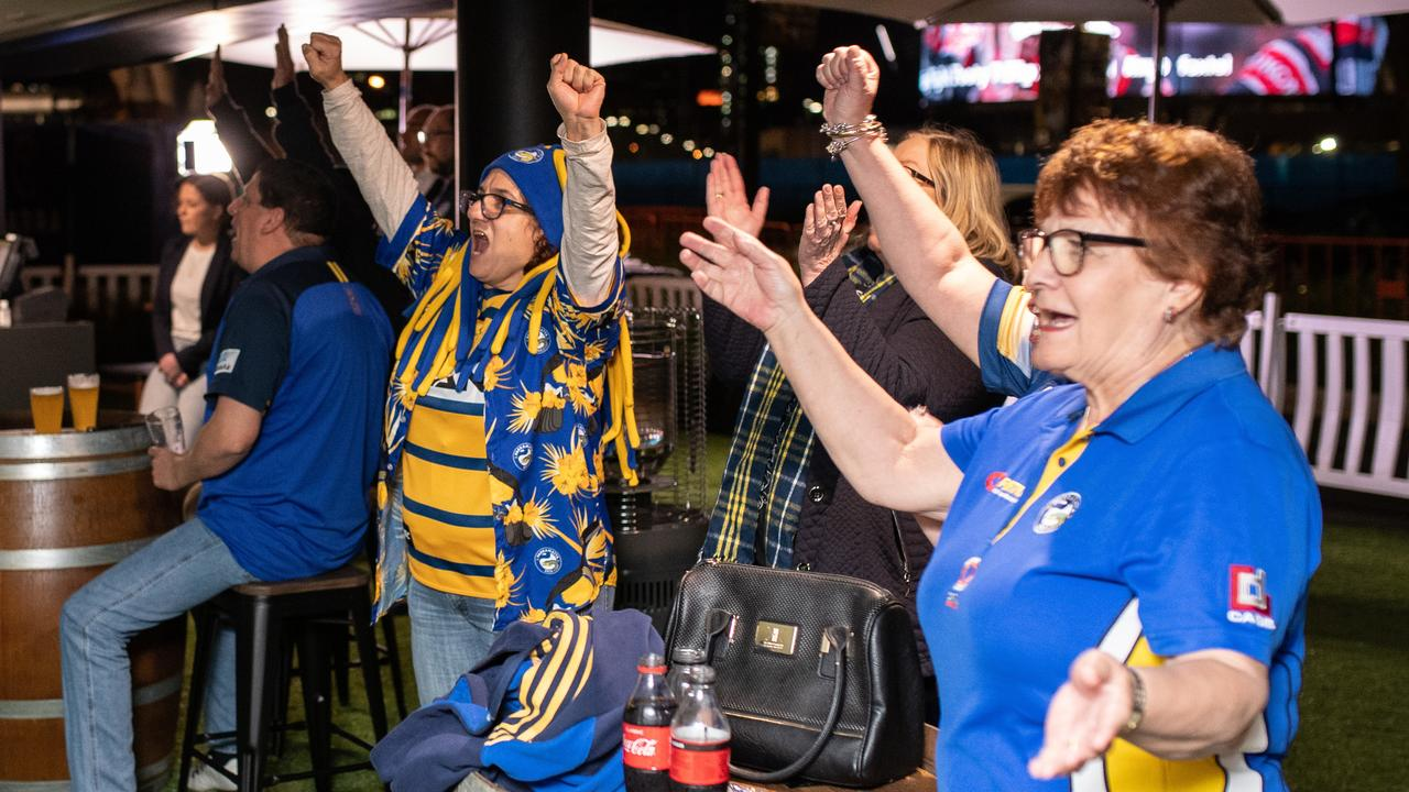 Away from the action, Eels fans celebrate a try during the NRL Round 3 match between Brisbane and Parramatta on Thursday. Picture: James Gourley/AAP