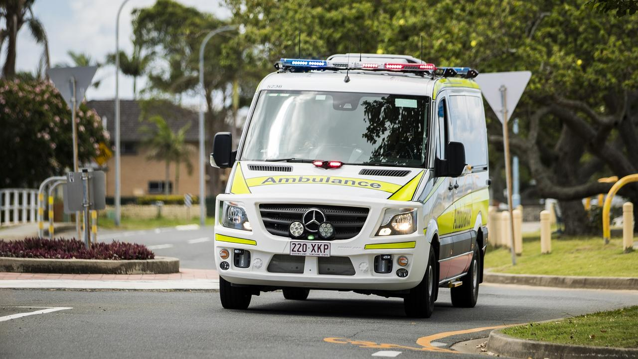 Paramedics treat a young girl in Glenvale after a traffic crash.