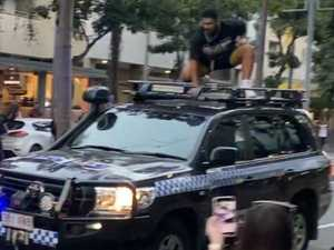 WATCH: BLM protester threatens cops, climbs on car