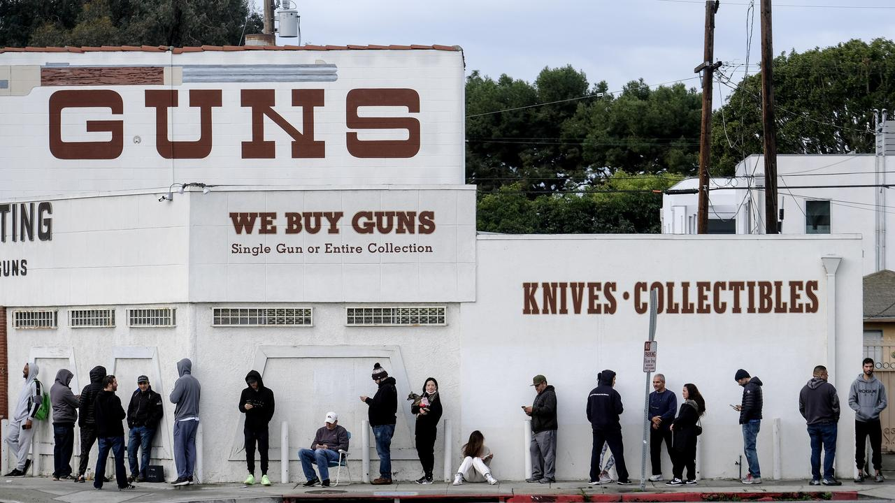 People wait in a line to enter a gun store in Culver City. Picture: Ringo H.W. Chiu