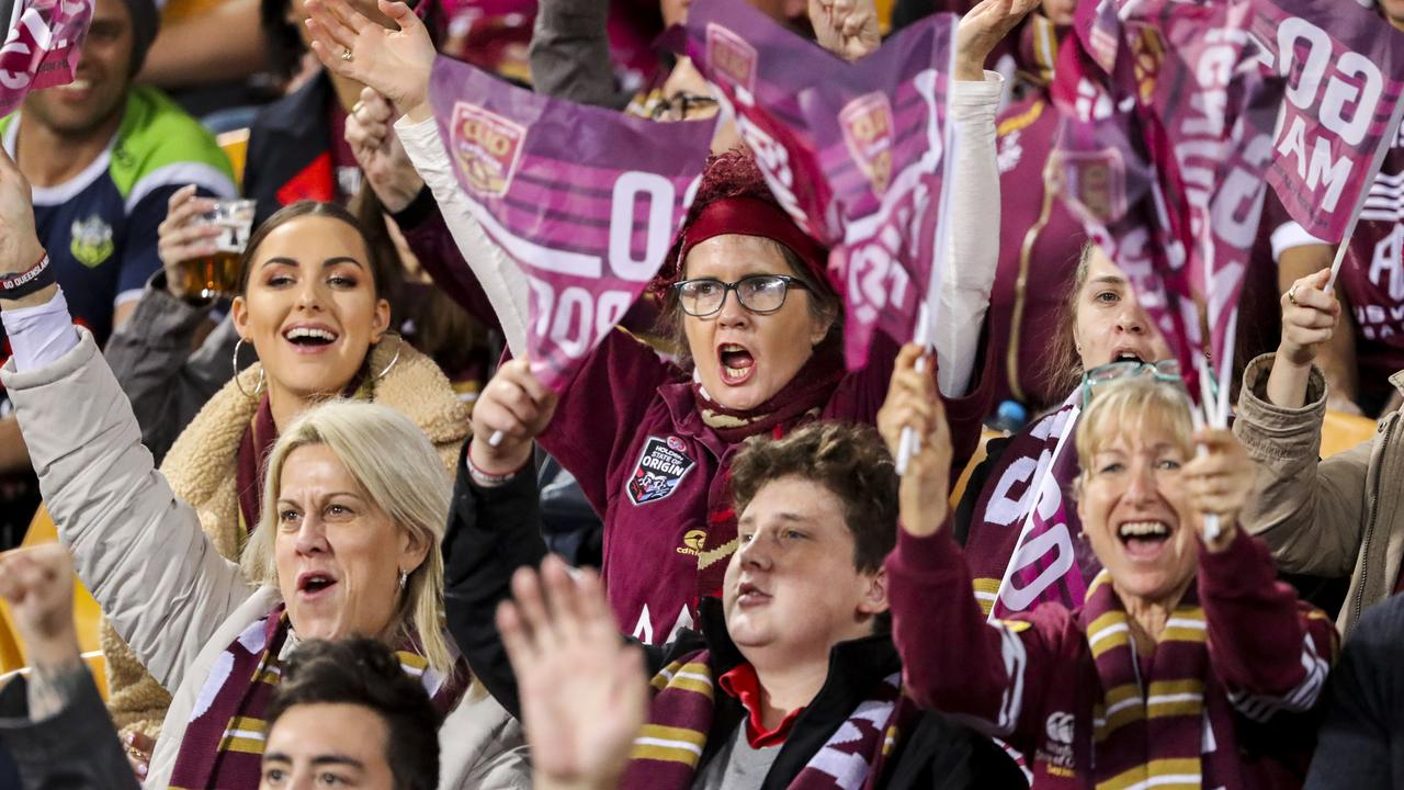 The stadium may not look as packed-in as these Maroons fans were last year but crowds could soon be returning to Queensland stadiums. (AAP Image/Glenn Hunt)