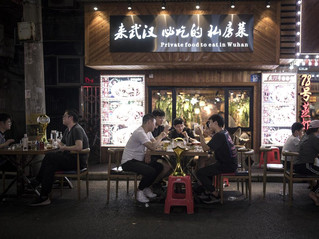 Residents having dinner in nearby Jiqing street in Wuhan. Picture: Getty