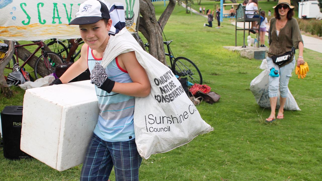 "HAPPY TRADE: Boy at previous Seaside Scanve collects rubbish to swap for ""treasure""."