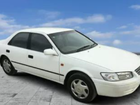 A 1999 white camry