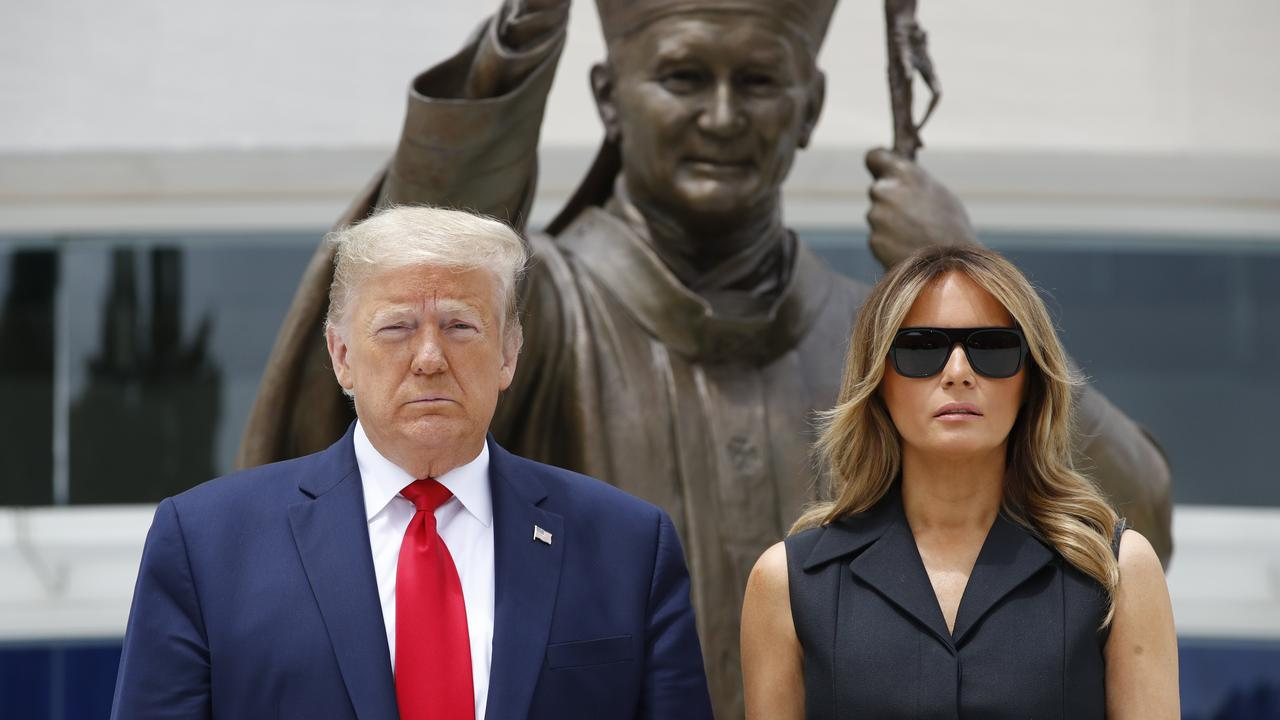 President Donald Trump and first lady Melania Trump visit Saint John Paul II National Shrine in Washington. Picture: AP Photo/Patrick Semansky