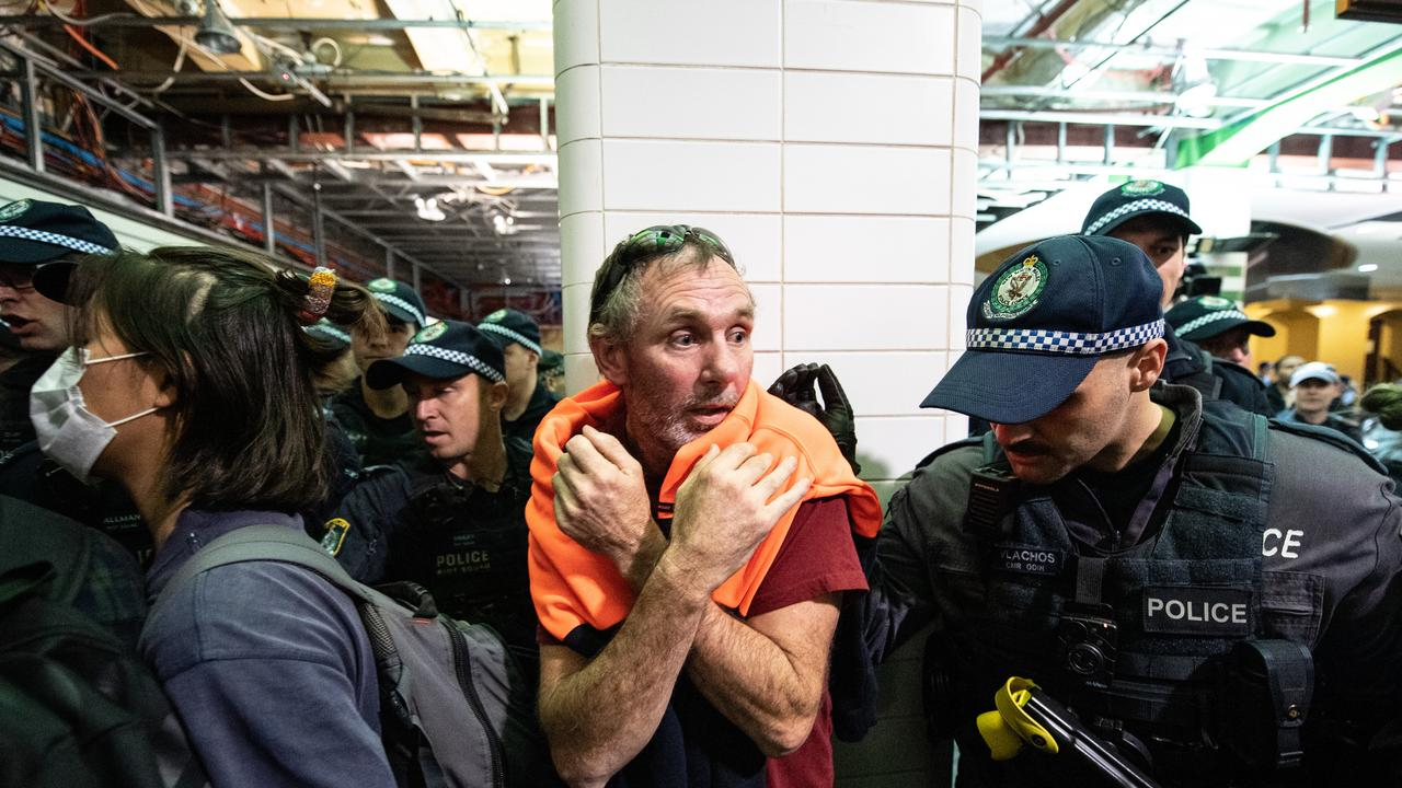 Police clashing with protestors inside Central Station after the rally in Sydney. Picture: AAP/James Gourley