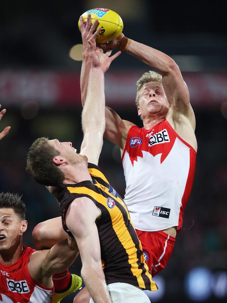 Isaac Heeney climbs above Ben McEvoy to mark against Hawthorn.