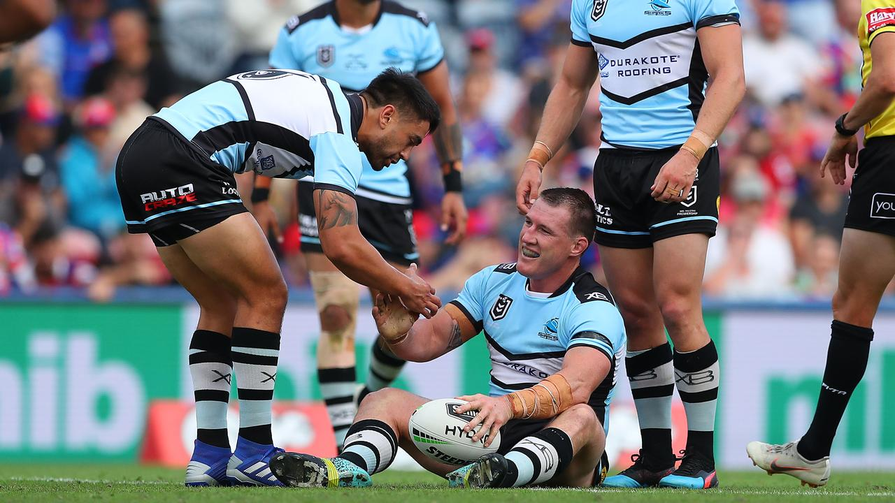 Et tu, Gal? Shaun Johnson gives Paul Gallen a helping hand. Picture: Getty