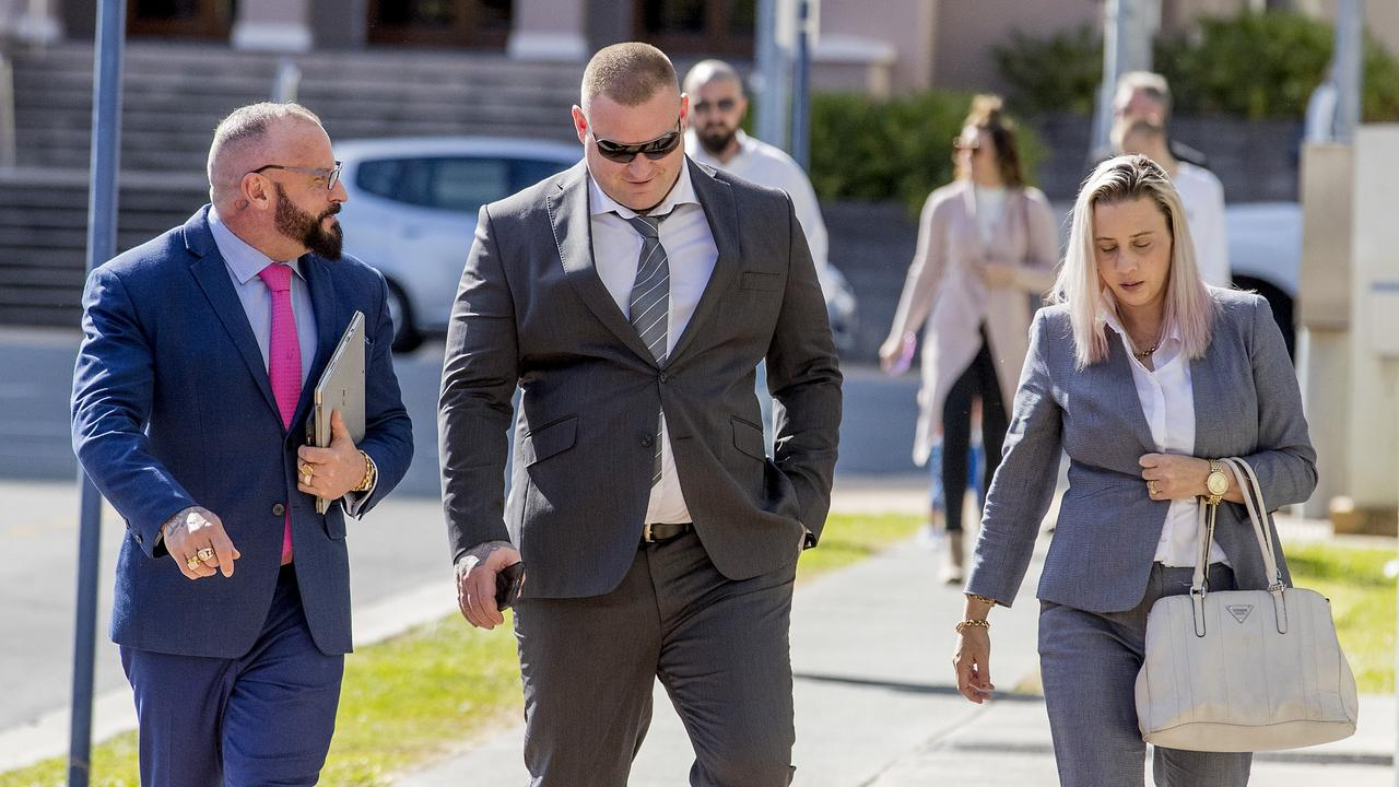 Steve Smith (centre) walking into the Southport Courthouse on Friday with his wife Carly Smith and his lawyer Campbell MacCallum of Moloney MacCallum Abdelshahied Lawyers(left). Picture: Jerad Williams