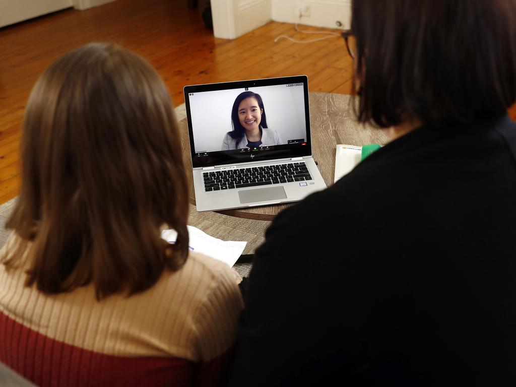 Joanne Gartside and her daughter Isobel Mandin take part in a video conference with Isobel's teacher Joanna Nivison-Smith. Picture: Sam Ruttyn