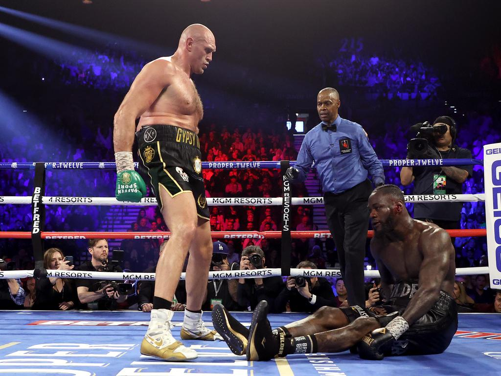 Tyson Fury stands over Deontay Wilder in their second fight. Picture: Al Bello/Getty