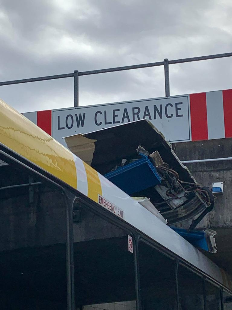A bus has become wedged under a bridge in Beenleigh. Photo: Bek Maclean