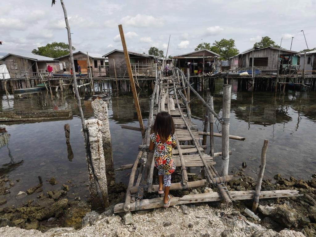 A child walks over to a bridge in Simariki coastal district in Zamboanga City, southern Philippines. Picture: EPA
