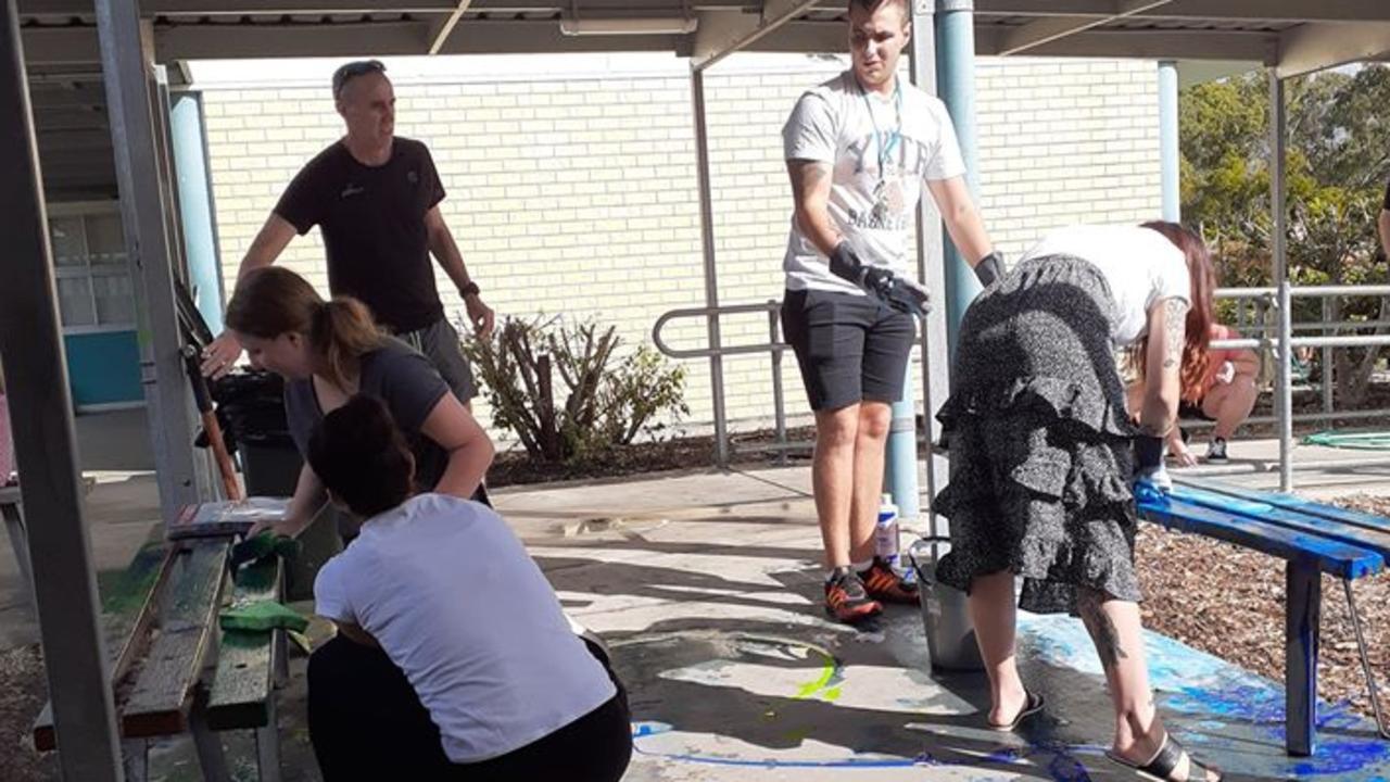 BIG JOB: Volunteers hard at work on Saturday afternoon following Tannum Sands State High School being vandalised.