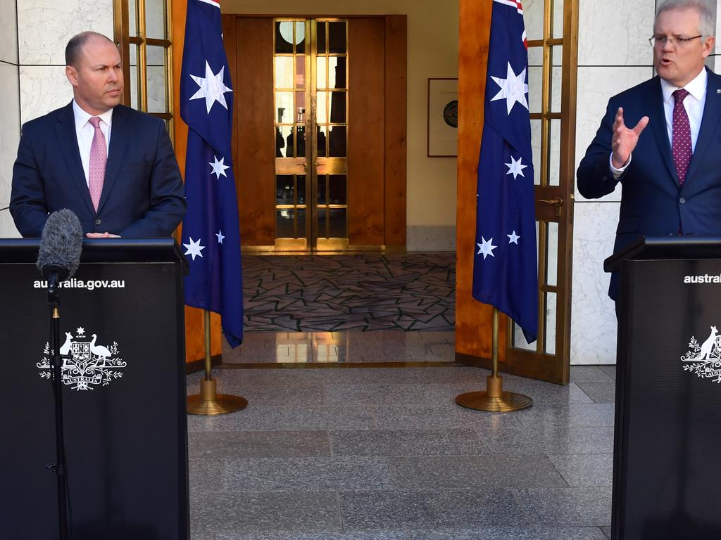 Prime Minister Scott Morrison and Treasurer Josh Frydenberg at a press conference at Parliament House in Canberra. Picture: AAP