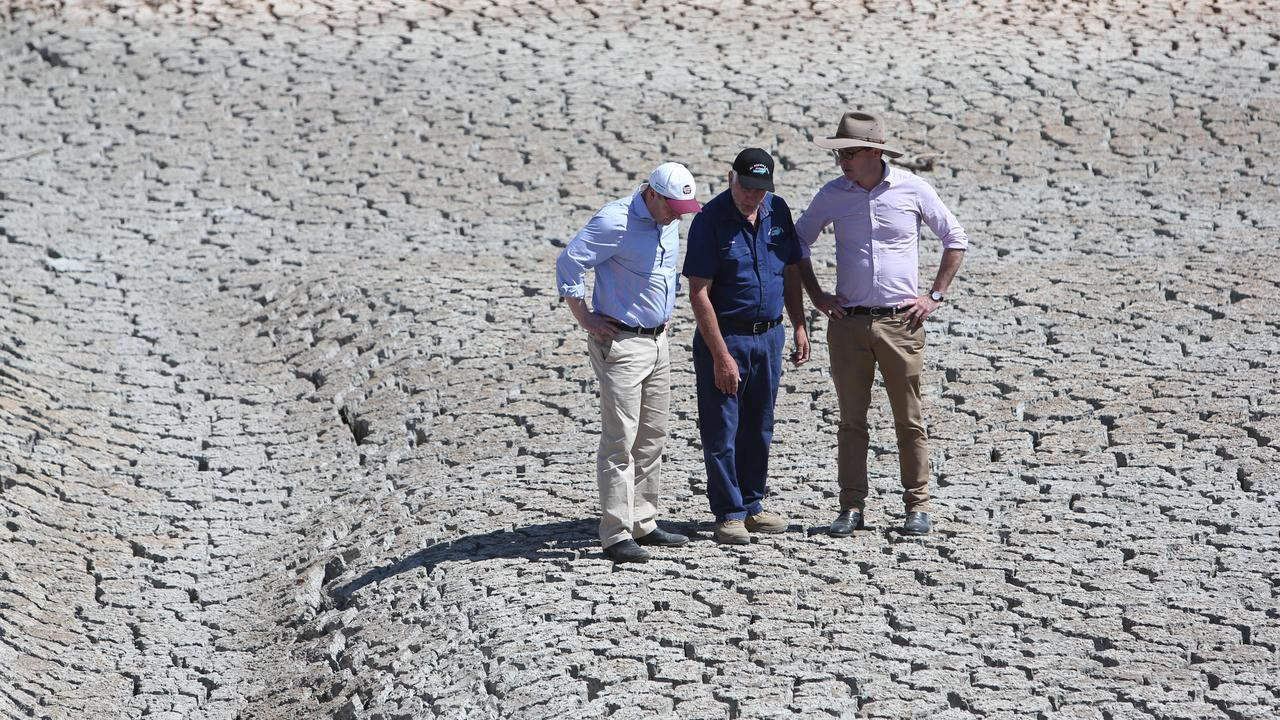 DRY AS A BONE: Treasurer Josh Frydenberg and Minister for Drought David Littleproud in the dry dam with Dino Rizzato, owner of I&L Rizzato & Sons apple orchard in Cottonvale. Picture: File