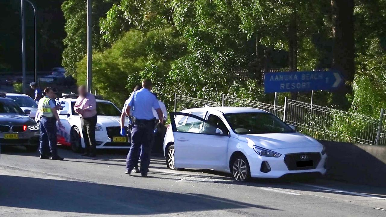 Officers from Coffs/Clarence Traffic and Highway Patrol following an alleged high speed pursuit which started at Glenugie and ended near the Big Banana at Coffs Harbour. Photo: Frank Redward