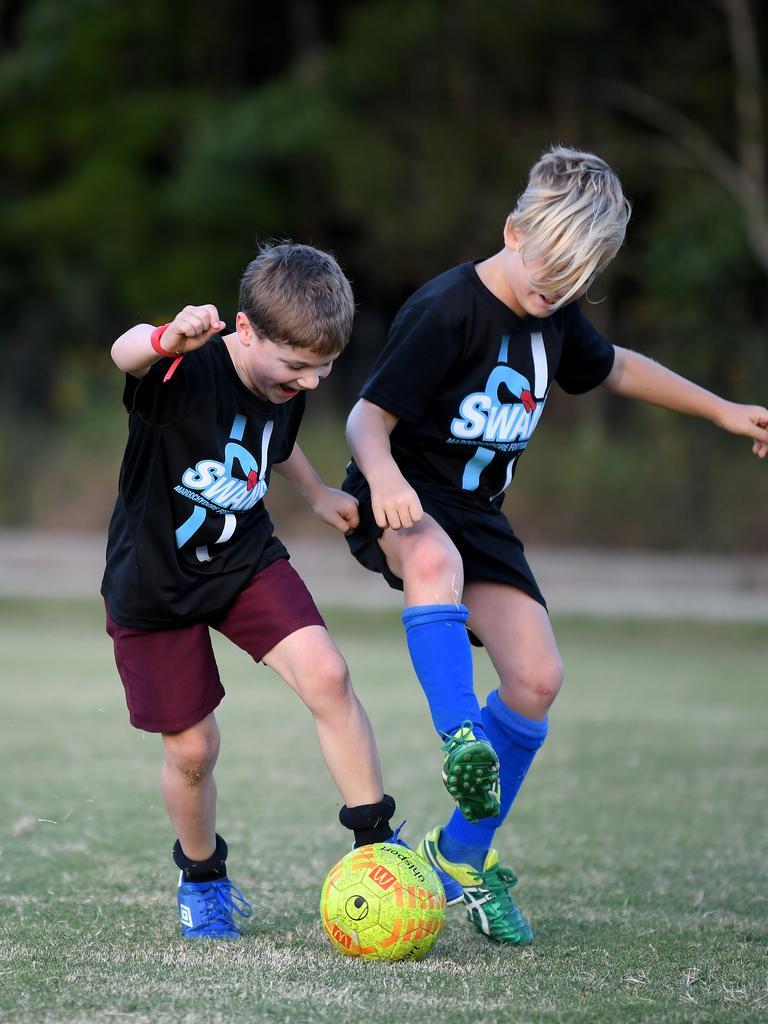 The U/8 Goannas from Maroochydore Football Club ready to get back on the field.Luke Claydon and Jasper Hills work on skills. Photo: Warren Lynam