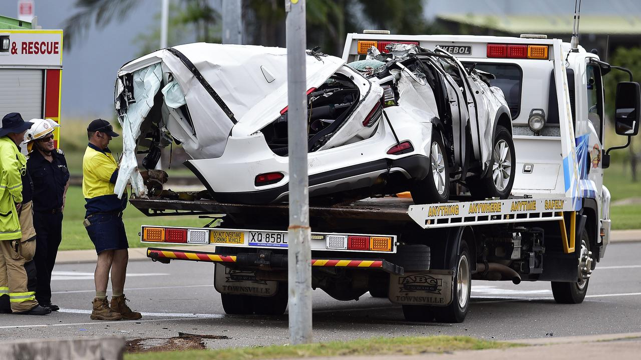 Tow truck workers load the wreckage of a car onto a truck after a fatal crash on Sunday. PICTURE: MATT TAYLOR.