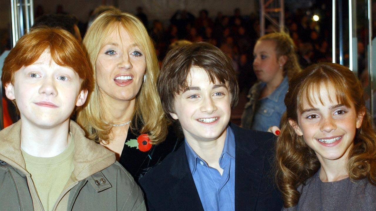 L-R: Rupert Grint, Daniel Radcliffe and Emma Watson with JK Rowling, at back, at the premiere of Harry Potter and the Philosopher's Stone in 2001. Picture: AP Photo/William Conran/PA