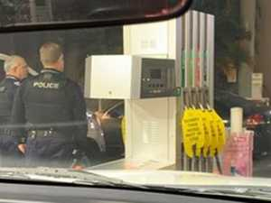 Woman dashes car at servo after quest for fuel, cigarettes
