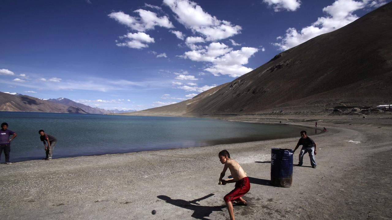 Children play cricket by Pangong Lake, near the India-China border in Ladakh, India. Picture: AP Photo/Channi Anand