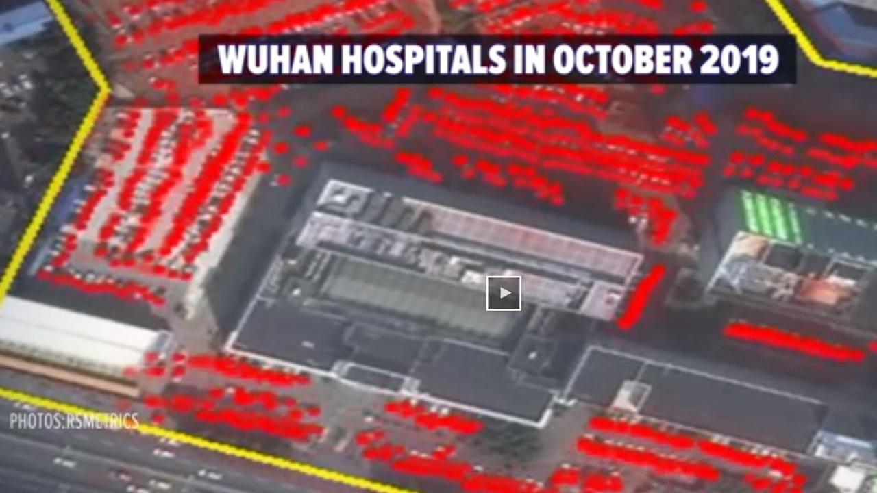 Satellite images of hospital parking lots in Wuhan suggest coronavirus started months earlier than originally thought. Picture: ABC US