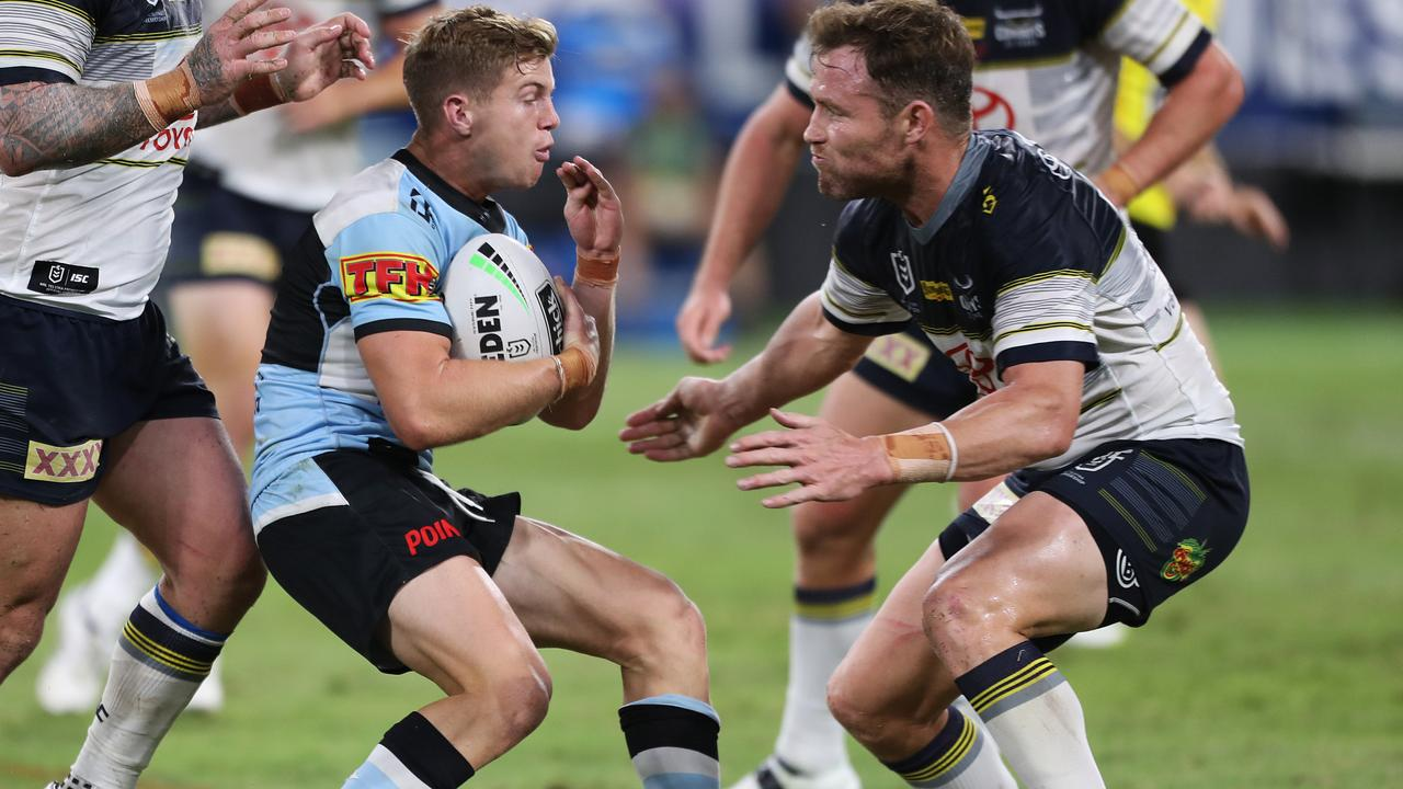 Gavin Cooper of the Cowboys prepares to tackle Blayke Brailey of the Sharks (left) during the Round 4 NRL match between the North Queensland Cowboys and the Cronulla-Sutherland Sharks at Queensland Country Bank Stadium. (AAP Image/Cameron Laird)
