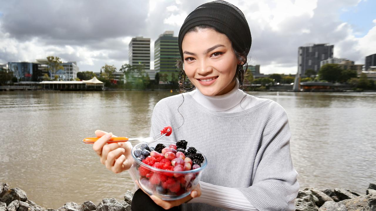 Brisbane's Razia Khalili with bowl of berries, which are one of the best foods for relieving stress in women. Steve Pohlner