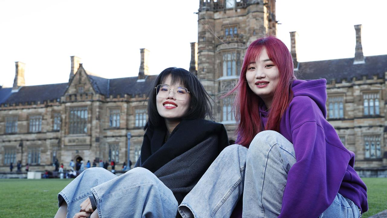 Chinese students, Adrian Hanhui Zi (right) and Cloris Jiang (left) at Sydney University. Picture: John Feder/The Australian.