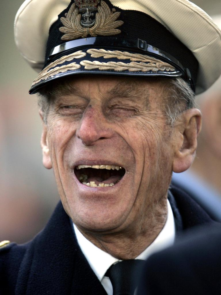 Britain's Prince Philip shares a joke with a war veteran in 2006. Picture: AP