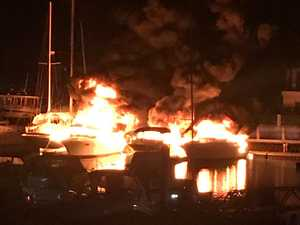 Owner among three charged with arson over marina blaze