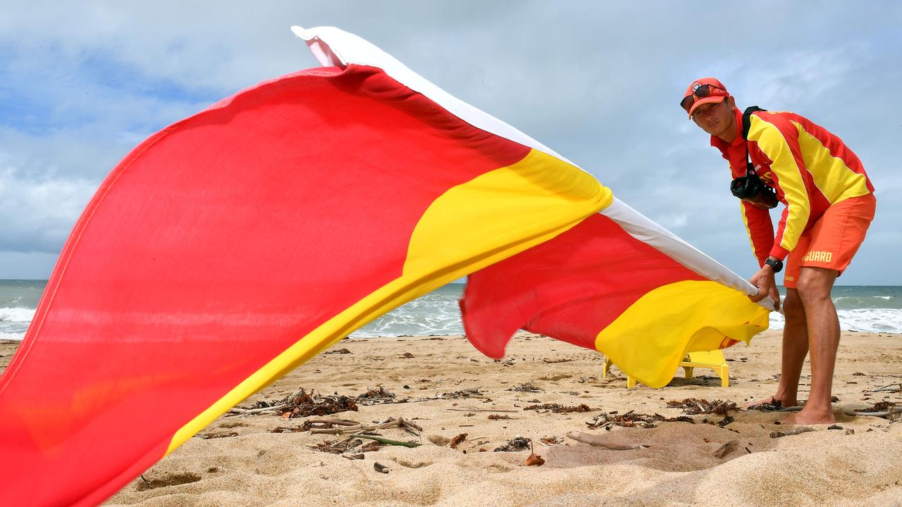 Lifeguard Tarryn Hayden was forced to pull down the flag on Harbour Beach in March, but this Saturday they will return to Mackay's patrolled beaches. Picture: Tony Martin