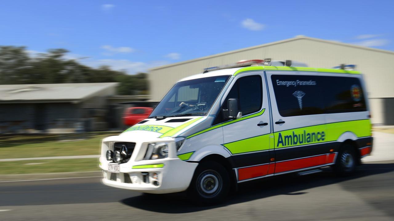Paramedics took an Emerald man to hospital after a trailer fell on him.