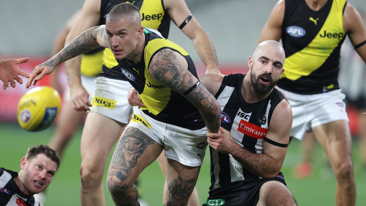 Steele Sidebottom tackles Richmond star Dustin Martin. Picture: Michael Klein
