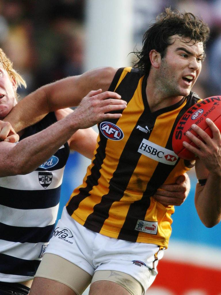 Jordan Lewis attempts to evade a tackle from Cameron Ling in 2006.