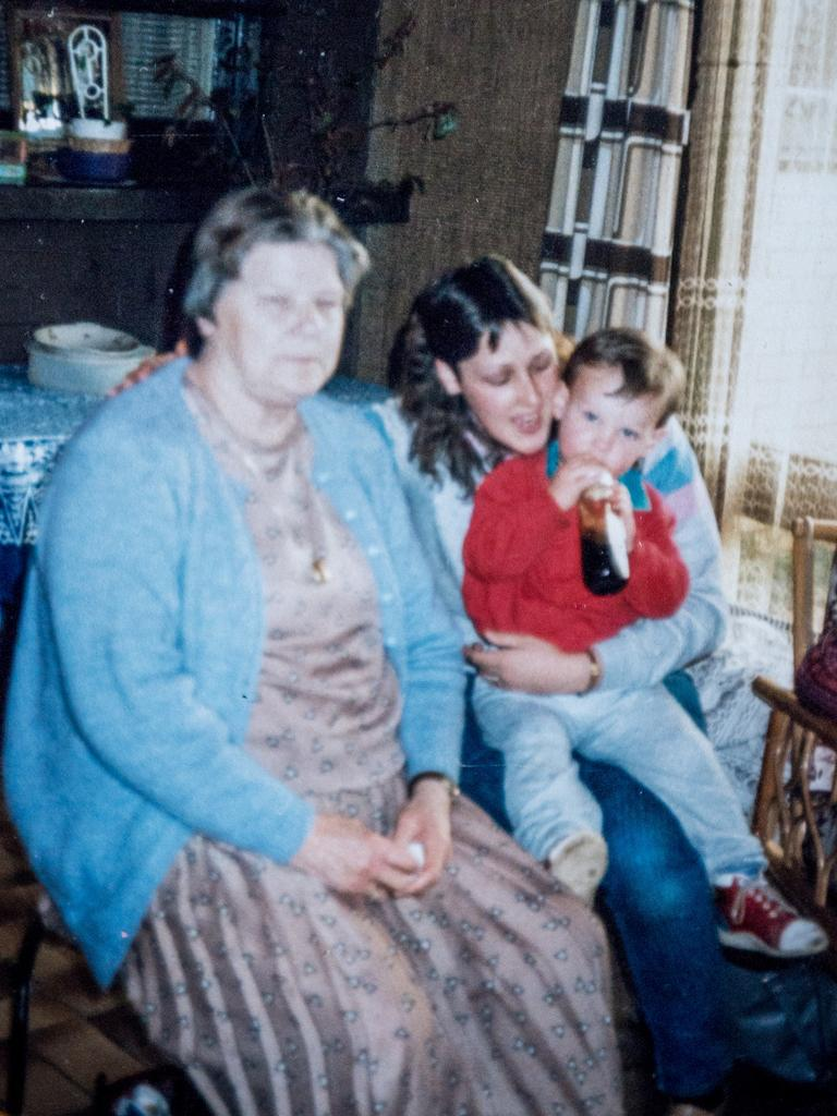 Reker as a young boy with his grandmother and mum.
