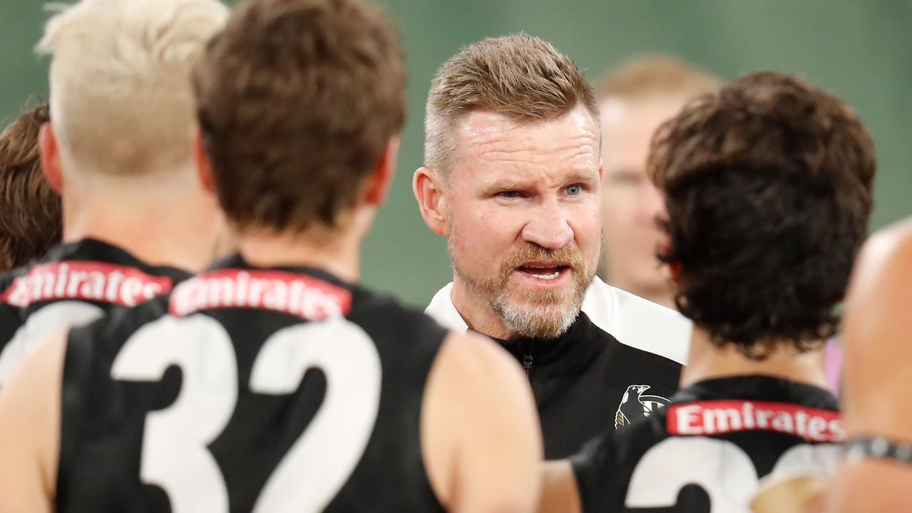 Nathan Buckley addresses his players.