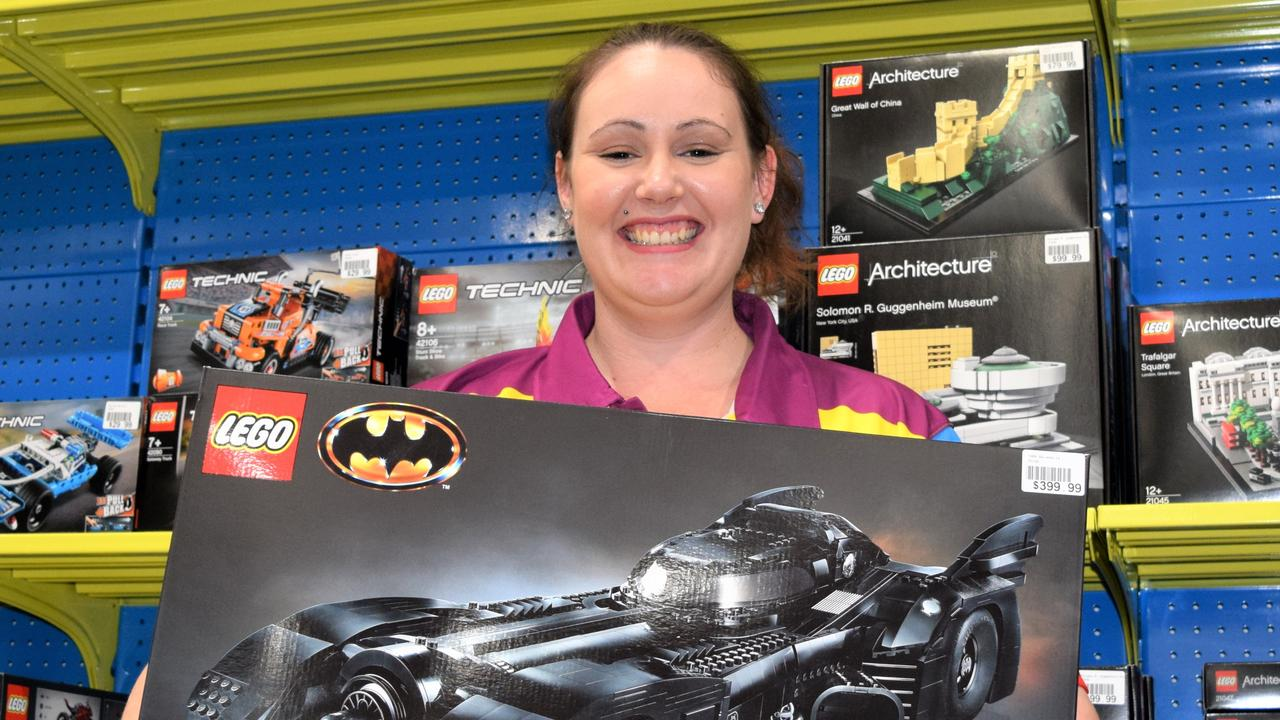 Toyworld Mackay manager Rebecca Hathaway with the Lego Batmobile set now available at Toyworld Mackay. Picture: Heidi Petith